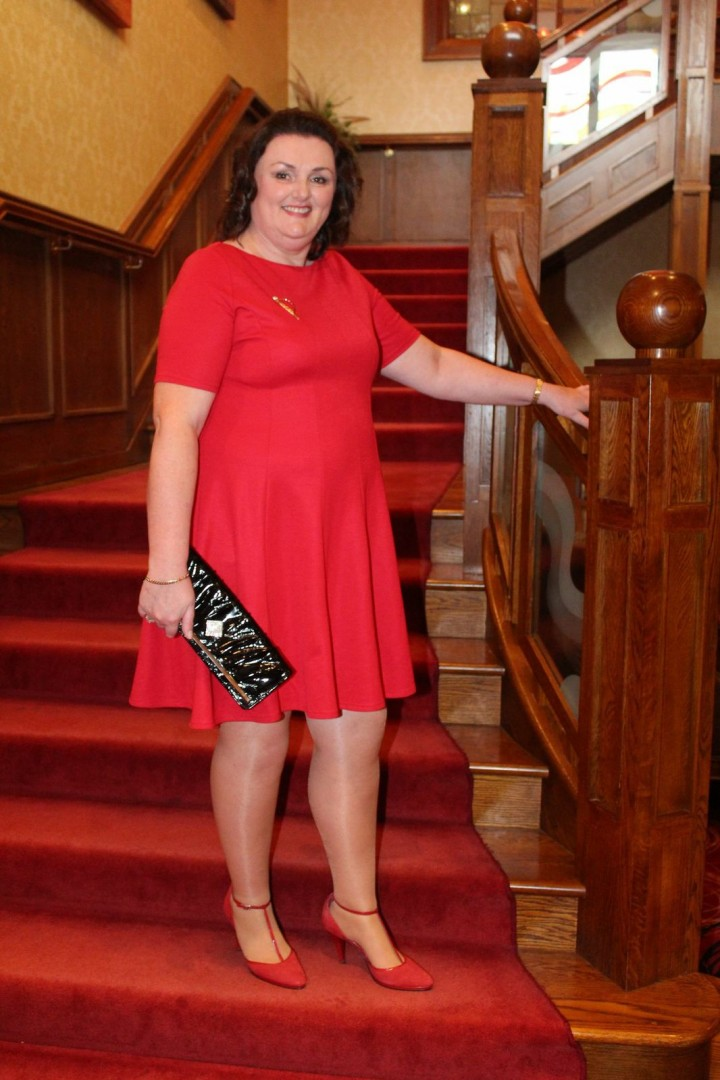 diane marshall, plus size model, in red skater dress